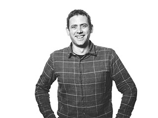 Porträttbild av Alex Hodge, arkitekt på Archus