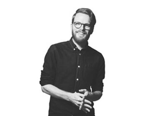 Porträttbild av Mikael Hassel, arkitekt och hållbarhetsansvarig på Archus