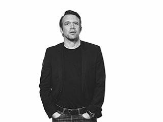 Porträttbild av Erik Bruhn, VD för Archus Arkitektur