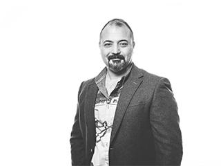Porträttbild av Salman Salman, affärsutvecklare på Archus